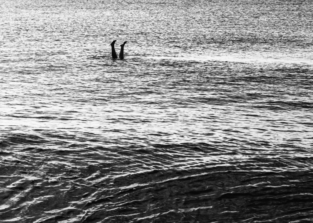 man going underwater